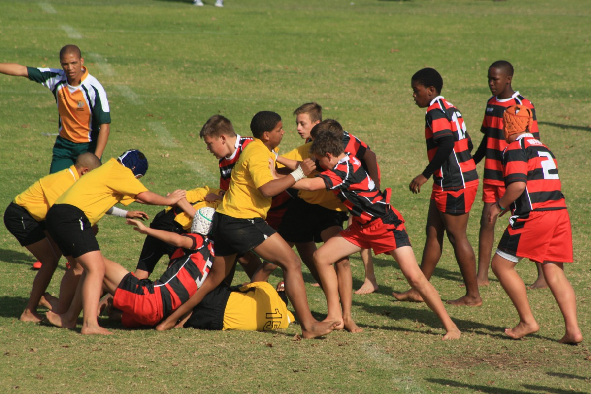 A young Wessel pushing off a large opponent in the scrum