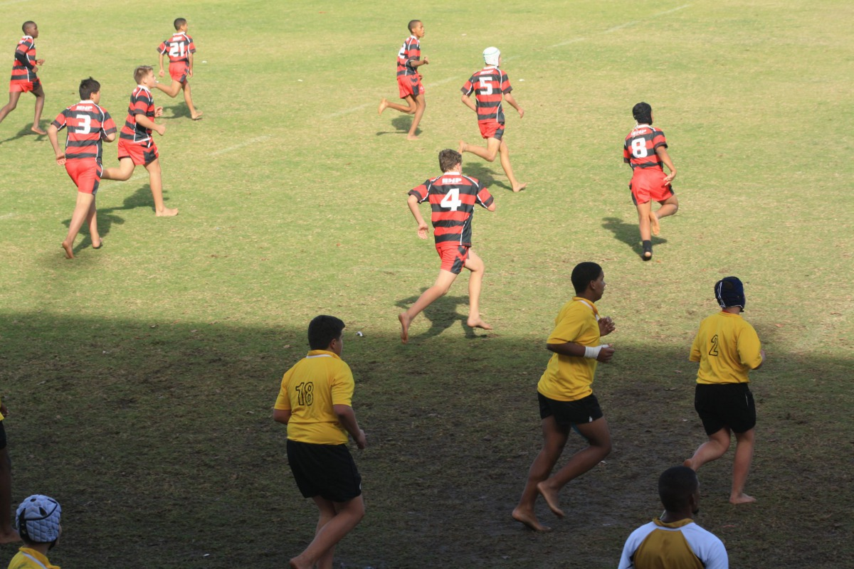 A young Wessel running after the ball on the field