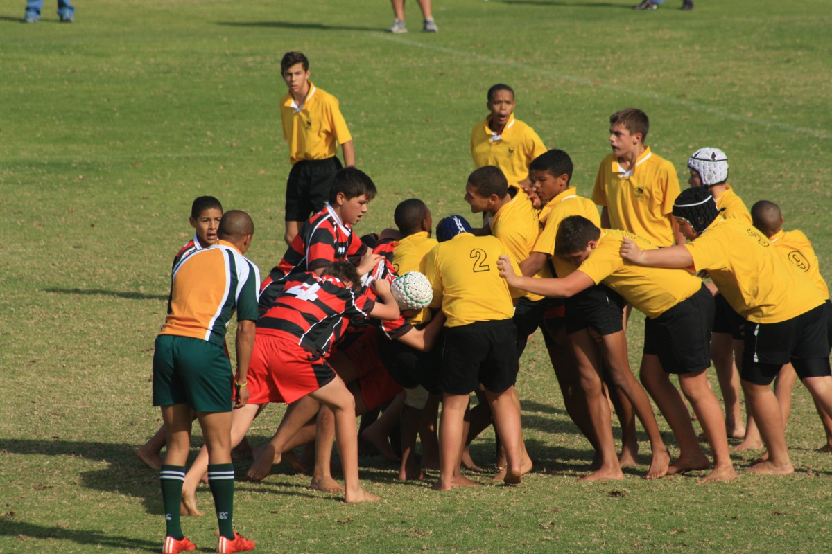 A young Wessel joining the scrum in a rugby game