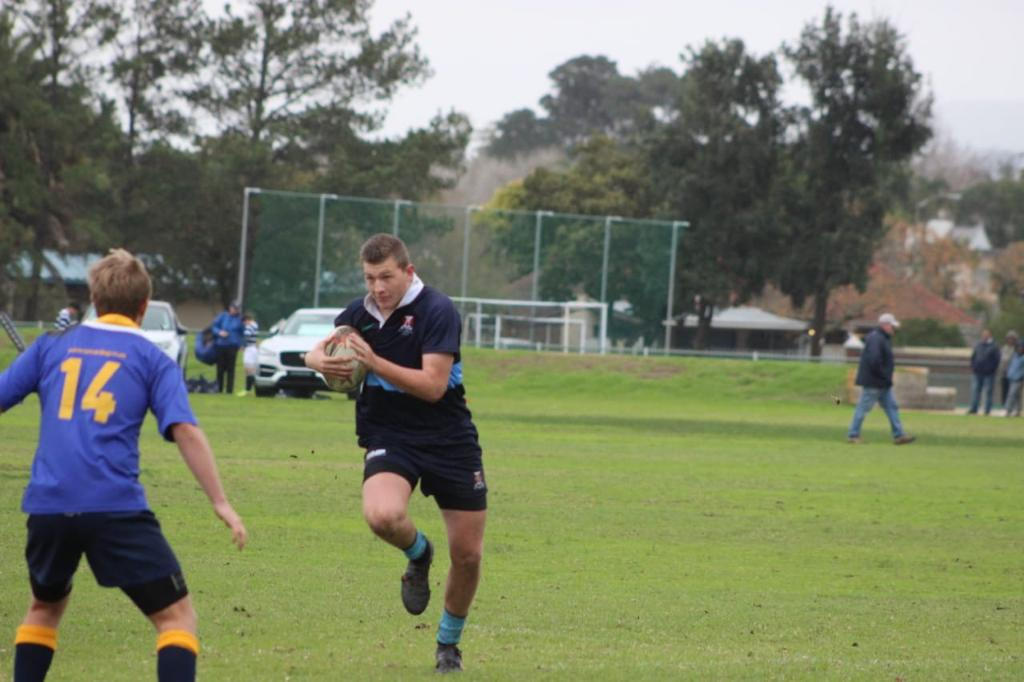 Wessel charging into an opponent with the ball
